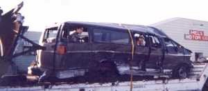 demolished side of van